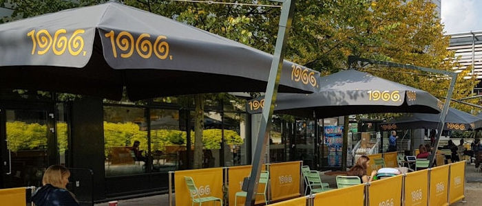 Brunel Installation of Cafe Barriers abd Giant Umbrellas by Brandline